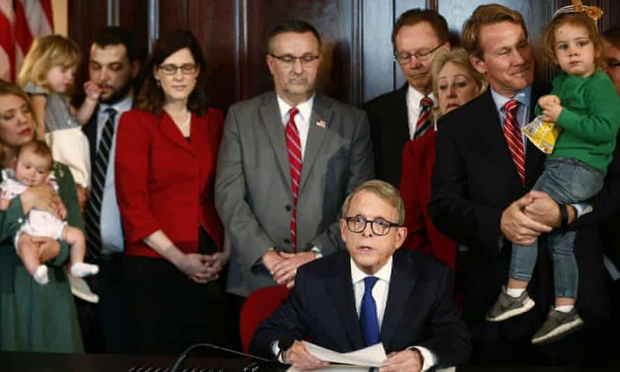 Governor Mike DeWine speaks signs a bill imposing one of the nation's toughest abortion restrictions, on 11 April 2019 in Columbus, Ohio.