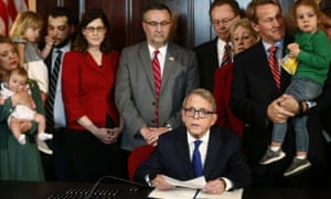 Ohio abortion law: the Ohio governor, Mike DeWine, signs the 'heartbeat bill', one of the nation's toughest abortion bans, on 11 April 2019.