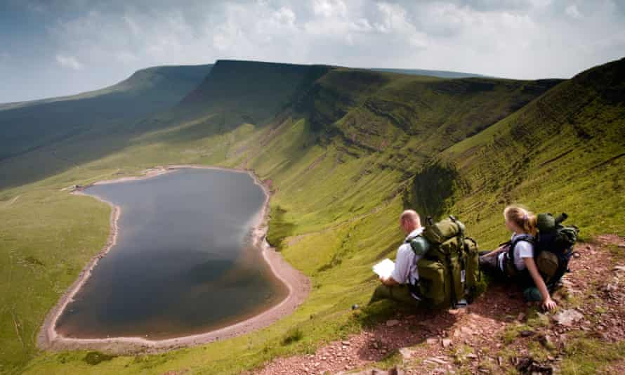 Walkers at Llyn y Fan Fach in the Brecon Beacons National Park at Powys, Wales