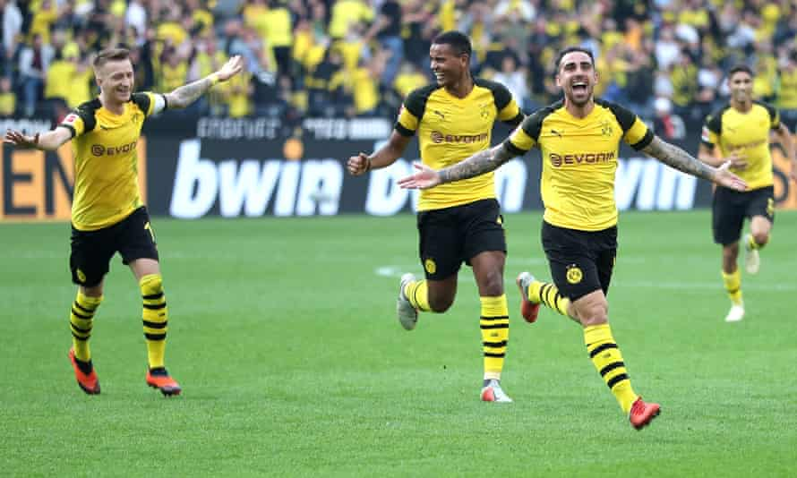 Paco Alcacer, second from right, celebrates his late winner for Dortmund.