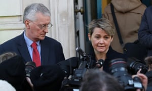 Hilary Benn and Yvette Cooper talking to the media as they leave the Cabinet Office.