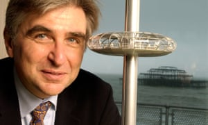 David Marks with a model of the pod of the British Airways i360 observation tower at its planning stage, following the destruction of the West Pier, background, by arson.