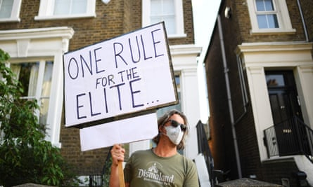 A protester outside the London home of Dominic Cummings last week.