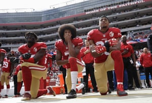 San Francisco 49ers outside linebacker Eli Harold, left, quarterback Colin Kaepernick, center, and safety Eric Reid kneel during the national anthem before an NFL football game against the Dallas Cowboys