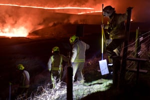 Fire and rescue service personnel from Greater Manchester and Huddersfield on Saddleworth Moor