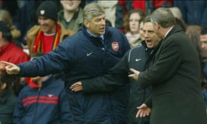 Arsène Wenger and Sir Alex Ferguson have to be separated by fourth official Alan Wiley during an Arsenal and Manchester United match at Highbury in March 2004
