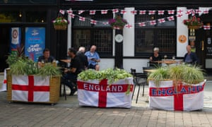 A pub in Uxbridge, London, has England flags and bunting outside in preparation for the Euro 2020 final on Sunday between England and Italy.