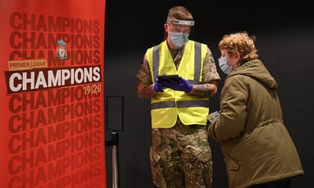 Soldiers operating a coronavirus test centre at Anfield stadium in Liverpool as part of a pilot mass testing programme, November 2020