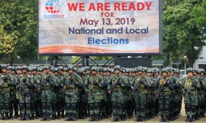 Philippine police and military prepare to be deployed for elections security.