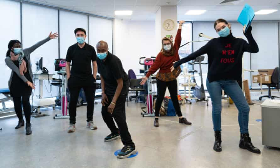 Staff at the Whittington hospital in north London take part in a theatre session run by Wake the Beast