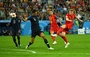 Belgium's Kevin De Bruyne leans back and the ball goes over the bar.