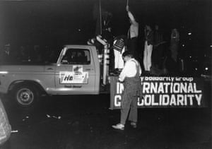Police trying to remove Lance Gowland from truck during the first Mardi Gras.