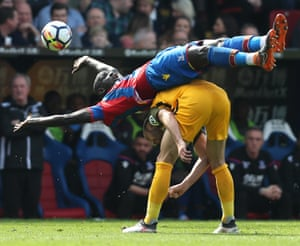 Crystal Palace's Mamadou Sakho falls over the top of Brighton's Glenn Murray as Palace win 3-2 at Selhurst Park.