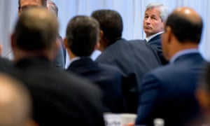 JPMorgan CEO Jamie Dimon, right, listens as President Barack Obama speaks to business leaders at the quarterly meeting on Wednesday.