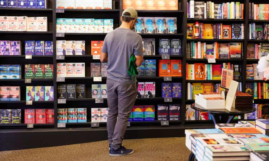 a man                 browses the shelves at Waterstones
