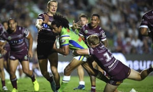 Iosia Soliola of the Canbera Raiders is tackled by Tom Trbojevic and Jake Trbojevic of the Manly Sea Eagles.