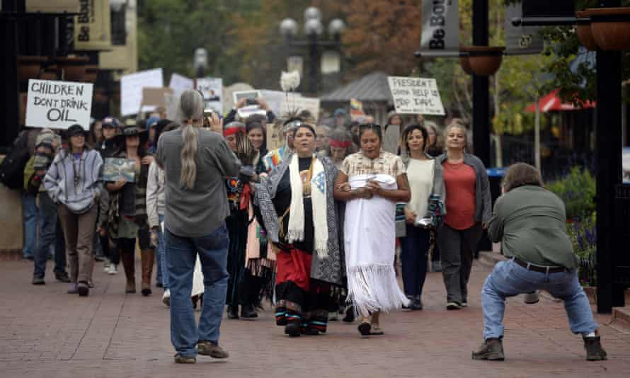 Standing Rock Sioux supporters with the Standing Rock Sioux during a rally on 13 September in Boulder, Colorado.