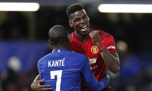 Manchester United's Paul Pogba celebrates as he hugs Chelsea's N'Golo Kanté at the end of the match.
