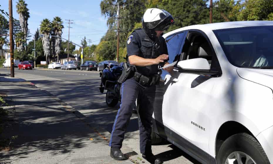 A police officer stops a driver in Santa Rosa, California, 10 October 2019.