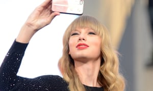 Taylor Swift takes a selfie.