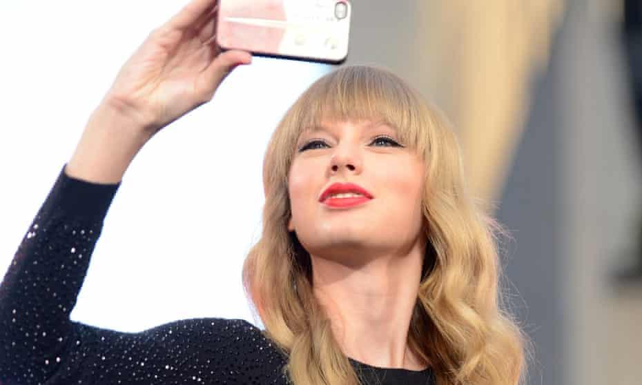 Taylor Swift takes a selfie.