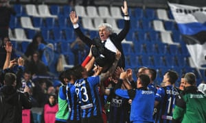 Atalanta's head coach Gian Piero Gasperini is tossed in the air by his players as they celebrate.