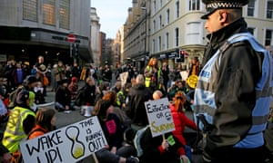 Extinction Rebellion climate protesters hold a sit-down protest in a Manchester street, 24 Novermber 2018.