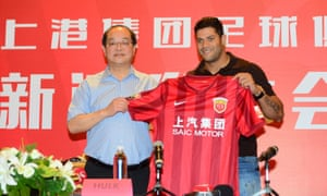 Brazilian forward Hulk poses after signing for Shanghai SIPG