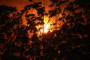 A red sunset as the fire front approaches Potato Point on NSW South Coast, 23 January