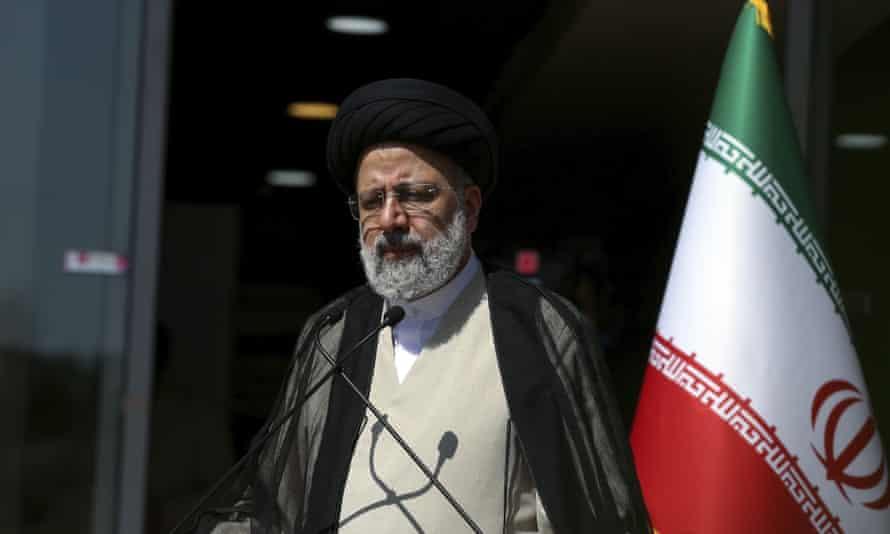 Ebrahim Raisi speaks with reporters from Iranian TV