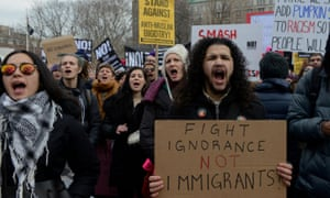 People protest against Donald Trump's immigration policy and the recent Ice raids in New York.