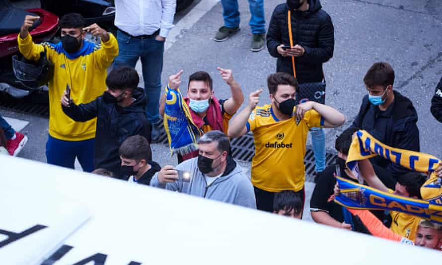Cádiz fans gesture at the Real Madrid team bus in one of the few moments of protest in Spain.