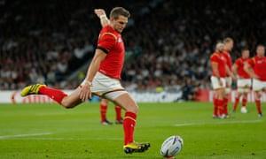 Dan Biggar kicks one his seven penalties during Wales's 28-25 victory over England at Twickenham.