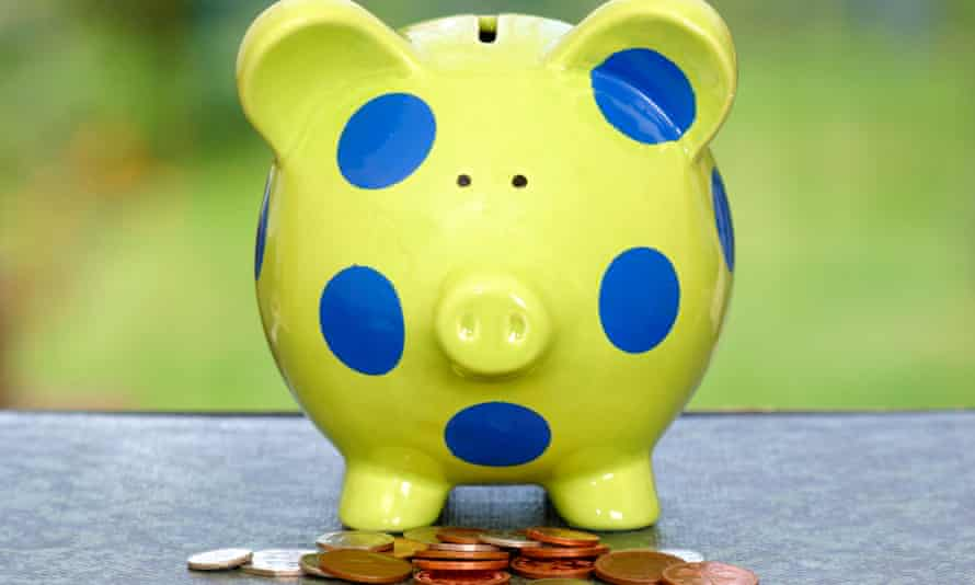 Green and blue spotted piggy bank with coins, , money bank for a child's savings, pocket money