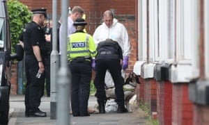 Police with a sniffer dog at an address in Banff Road, Rusholme