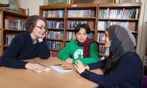 Kate Clanchy photographed at Oxford Spires Academy, Oxford with Mukahang Limbu, centre, and Halema Malak, right