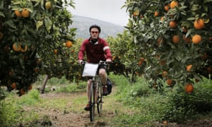 Kevin Rushby cycling through the orange groves in the Anapo valley, Sicily