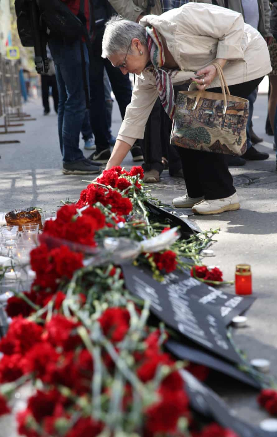 A woman lays flowers outside the Ukrainian embassy in Moscow.
