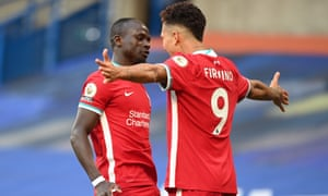Liverpool's Sadio Mane [left] celebrates scoring.