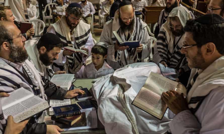 Ultra-Orthodox Jewish men pray at the Western Wall during Yom Kippur in Jerusalem.