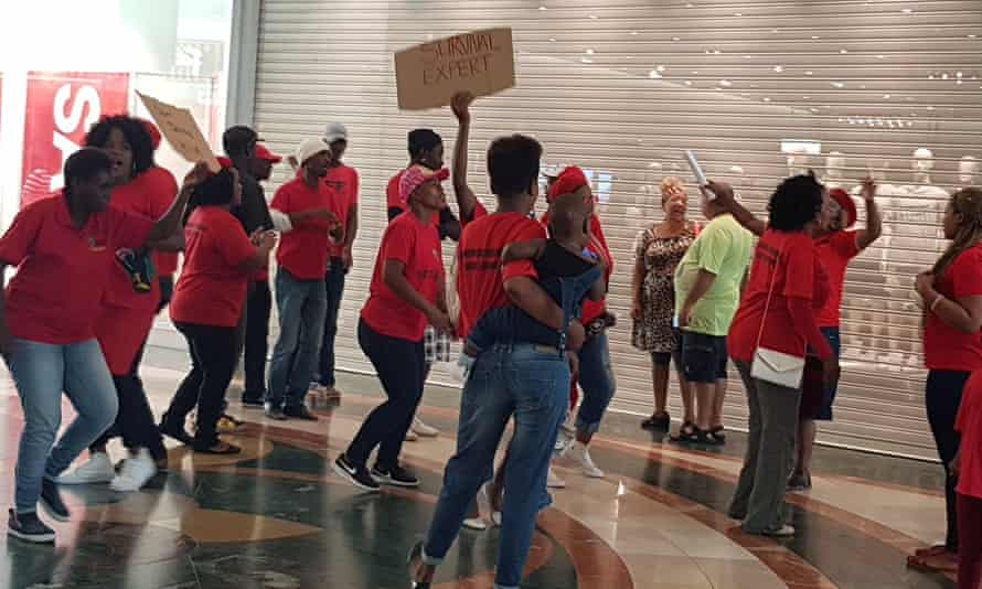 Protesters in front of an H&M store in Cape Town on Saturday.