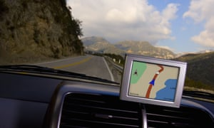 Satnav screen in car on mountain road