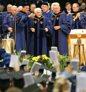 Harper Lee was awarded an honorary degree by the University of Notre Dame, Indiana in 2006, and the class of 2006 hold up copies of her book during the commencement ceremony.