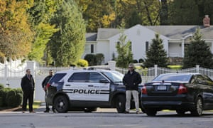 Police officers stand in front of property owned by Hillary and Bill Clinton in Chappaqua, N.Y.