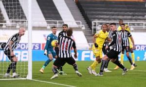 Newcastle's Matt Ritchie scores an own-goal just before half-time.