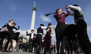 Folk dancers perform in Heroes Square, Budapest, to mark the centenary of the Trianon treaty.