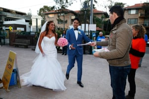 The pair nip in to cast their votes after tying the knot