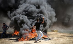 People take part in protests at the Israel-Gaza border