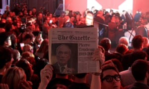 A supporter holds up an old issue of The Gazette newspaper featuring former prime minister Pierre Trudeau, father of Liberal Party leader Justin Trudeau.