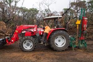 Steve Hewitt operating machinery